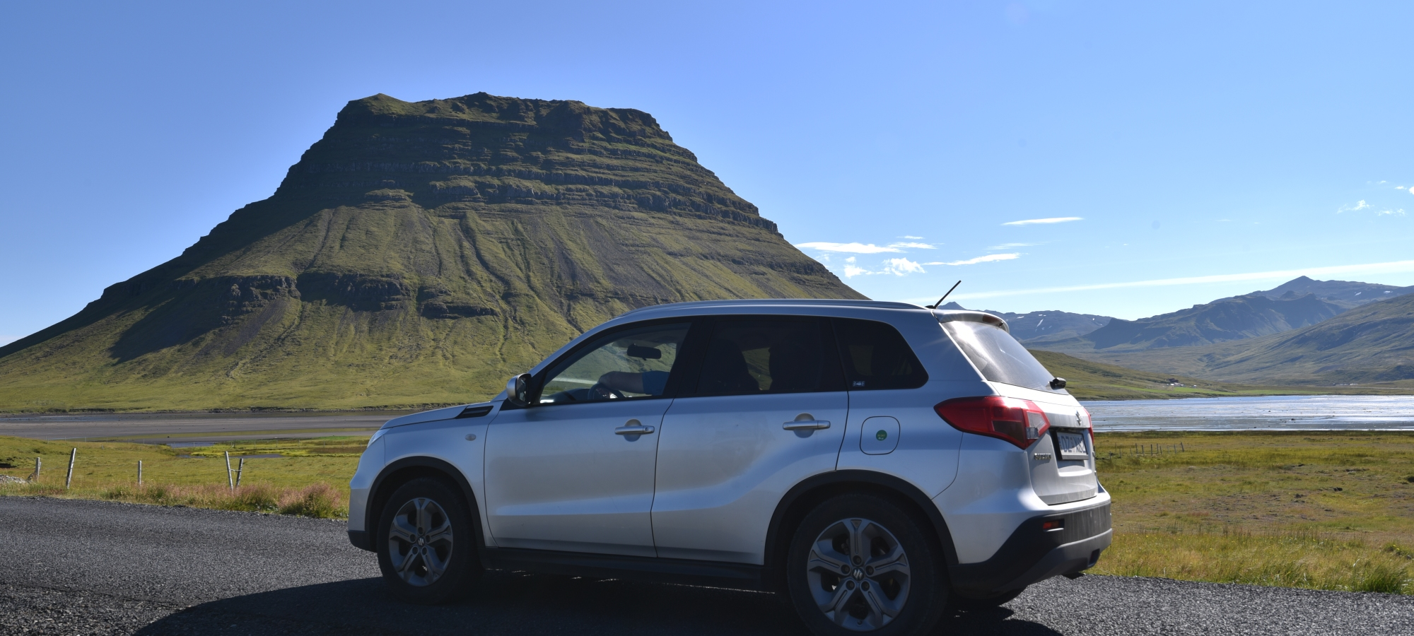 rental car from blue car rental Iceland with kirkjufell in the background