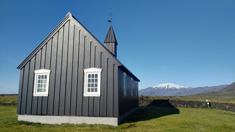 Búðakirkja church with the Snæfellsjökull glacier at the horizon.